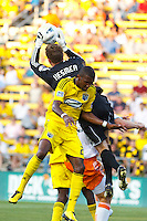24 JULY 2010:  William Hesmer of the Columbus Crew (1) gabs the ball over Shaun Francis of the Columbus Crew (29) during MLS soccer game between Houston Dynamo vs Columbus Crew at Crew Stadium in Columbus, Ohio on July 3, 2010. Columbus defeated the Dynamo 3-0.