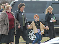 Mourners leave the funeral for Sago miner Jesse Jones Sunday, Jan. 8, 2006, in Buckhannon, WV Jones is one of 12 miners killed in the Sago mine explosion (Gary Gardiner/EyePush Newsphotos)<br />