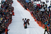 Nick Petit runs down the chute past spectators during the restart of the 2019 Iditarod race in Willow, Alaska.<br /> <br /> Photo by Jeff Schultz/  (C) 2019  ALL RIGHTS RESERVED