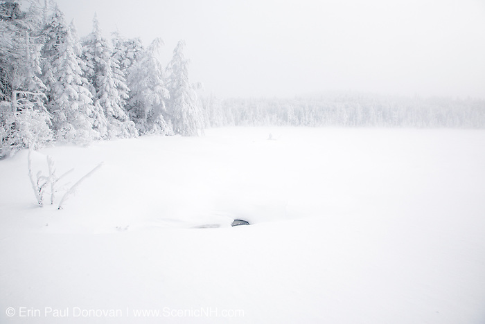 Franconia Notch - Lonesome Lake during the winter months in the White Mountains, New Hampshire USA in whiteout conditions.