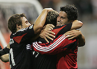 30 October,  2004. Jaime Moreno (99) is congratulated by his DC United teammates after scoring on the MetroStars  during the 2004 MLS playoffs at RFK Stadium in Washington, DC.