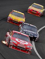 Feb 22, 2009; Fontana, CA, USA; NASCAR Sprint Cup Series driver Juan Pablo Montoya leads a pack of cars during the Auto Club 500 at Auto Club Speedway. Mandatory Credit: Mark J. Rebilas-