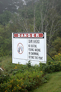 """Danger """"Dam ahead """" sign at Moore Dam  Located in Littleton, New Hampshire, USA which is part of New England"""