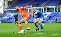Blackpool's CJ Hamilton shields the ball from Peterborough United's Dan Butler<br /> <br /> Photographer Chris Vaughan/CameraSport<br /> <br /> The EFL Sky Bet League One - Peterborough United v Blackpool - Saturday 21st November 2020 - London Road Stadium - Peterborough<br /> <br /> World Copyright © 2020 CameraSport. All rights reserved. 43 Linden Ave. Countesthorpe. Leicester. England. LE8 5PG - Tel: +44 (0) 116 277 4147 - admin@camerasport.com - www.camerasport.com