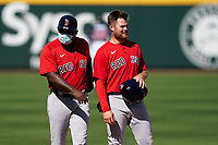 Boston Red Sox third base coach Carlos Febles (52) and Christian Arroyo (39) during a Major League Spring Training game against the Atlanta Braves on March 7, 2021 at CoolToday Park in North Port, Florida.  (Mike Janes/Four Seam Images)