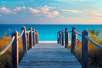 Board pathway to ocean. Grace Bay, Providenciales. Turks and Caicos.