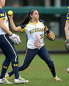 Michigan Wolverines shortstop Sierra Romero (32) throws the ball during the season opener against the Florida Gators on February 8, 2014 at the USF Softball Stadium in Tampa, Florida.  Florida defeated Michigan 9-4 in extra innings.  (Copyright Mike Janes Photography)