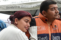 """MEDELLIN -COLOMBIA- 14 -10-2013. La señora Yuli Contreras y Wilmar Contreras en la espera del rescate se su hermano desaparecido Ubeimar Contreras (vigilante ) entre los desaparecidos, en las afueras donde la  torre seis de la unidad residencial Space se derrumbo este sábado en la noche. El edificio que está situado en el sector del poblado en la  Loma del Padre Marianito , deja dos personas heridas y varios desaparecidos  , Medellín Octubre 14 de 2013 .<br />  La Alcaldía y las autoridades de la ciudad de Medellín, conjuntamente con los ingenieros de LŽrida CDO SA alertaron que la Torre 5 del edificio residencial Space, contigua a la Torre 6, que se desplomó el sábado por la noche, presenta """"riesgo inminente de colapso"""". Segœn la Alcaldía de Medellín, un comité técnico encargado de hacer la evaluación del estado de la unidad residencial Space en el barrio El Poblado analizó este lunes la situación y concluyó que la Torre 5 puede derrumbarse en cualquier momento porque tiene fracturas en dos columnas. / Yuli Mrs. Contreras and Contreras Wilmar pending rescue her missing brother Ubeimar Contreras ( guard) among the missing , outside the tower where six of the residential unit collapsed Space this Saturday night . The building is located in the village sector in the Loma del Padre Marianito , leaves two people injured and several missing , Medellin October 14th of 2013 .<br /> ÊThe Mayor and the authorities of the city of Medellin , in conjunction with engineers from Lleida CDO SA warned that the tower 5 Space residential building , adjacent to the Tower 6, which collapsed on Saturday night , presents """" imminent risk of collapse """" . According to the Mayor of Medellin , a technical committee to assessing the state of the housing units in the affluent Space Poblado Monday analyzed the situation and concluded that the Tower 5 may collapse at any moment because it has broken in two columns. .Photo: VizzorImage / Luis Rios / Stringer"""