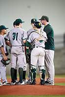 Siena Saints pitching coach Steve Adkins (right) talks with starting pitcher Brendan White (31) as catcher Phil Madonna (3), third baseman Yasser Santana (left), and first baseman Joe Drpich (back) listen in during a game against the Florida Gators on February 16, 2018 at Alfred A. McKethan Stadium in Gainesville, Florida.  Florida defeated Siena 7-1.  (Mike Janes/Four Seam Images)