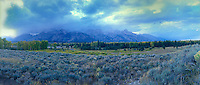 937000022 panoramic view of a clearing fall storm over the teton range with native plants trees and grasses seen from blacktail ponds overlook in grand tetons national park wyoming