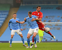 10th January 2021; Etihad Stadium, Manchester, Lancashire, England; English FA Cup Football, Manchester City versus Birmingham City; Kevin De Bruyne of Manchester City competes for the ball with Ivan Sunjic of Birmingham City