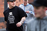 "© Joel Goodman - 07973 332324 . 02/04/2011 . Blackburn , UK . A man wearing a t-shirt reading "" Right wing extremists with shaven heads and quilted jackets "". The English Defence League ( EDL ) hold a demonstration in Blackburn . Photo credit : Joel Goodman"