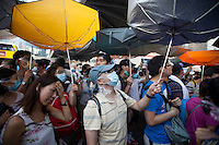 Pro-democracy protesters block the the main highway through Admiralty, next to the Hong Kong government headquarters in Hong Kong's downtown district, on the first day of the mass civil disobedience campaign Occupy Central, Hong Kong, China, 28 September 2014.