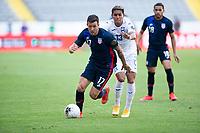 GUADALAJARA, MEXICO - MARCH 28: Aaron Herrera #17 of the United States  runs past Luis Palma #13 of Honduras during a game between Honduras and USMNT U-23 at Estadio Jalisco on March 28, 2021 in Guadalajara, Mexico.
