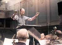 Sergei Prokofiev (1891-1953) conducting an orchestra in Russia, 1940s. He is regarded as one of the greatest composers of the 20th century. <br /> <br /> State Film and Photo Archive
