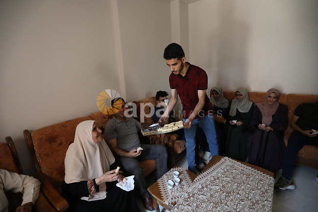 Six brothers from the Khatib family (three males and three females) celebrate with their family after their success in final exams known as ''Tawjihi'', in al-Bureij in the center of Gaza strip, on August 4, 2021. Photo by Ashraf Amra
