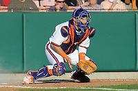 Catcher Spencer Kieboom #18 of the Clemson Tigers fields a throw to the plate during  a game against the North Carolina Tar Heels at Doug Kingsmore Stadium on March 9, 2012 in Clemson, South Carolina. The Tar Heels defeated the Tigers 4-3. Tony Farlow/Four Seam Images.