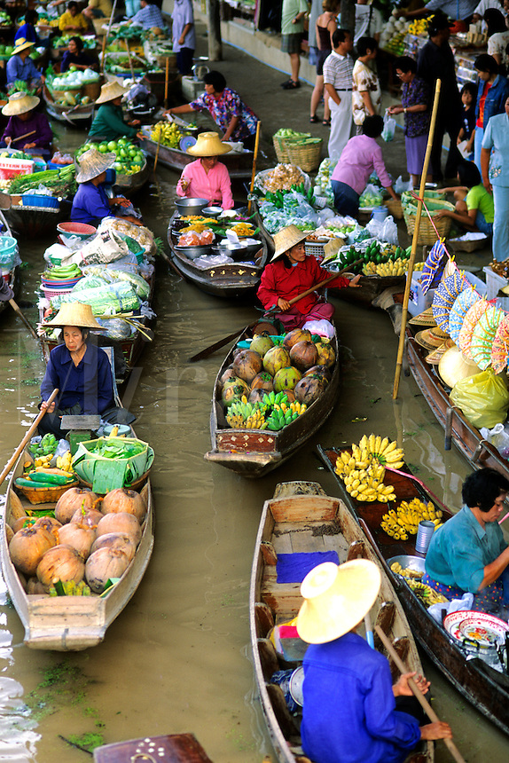 Color graphic image of shopping boats at the famous Floating Market at Damnernsaduak near Bangkok Thailand