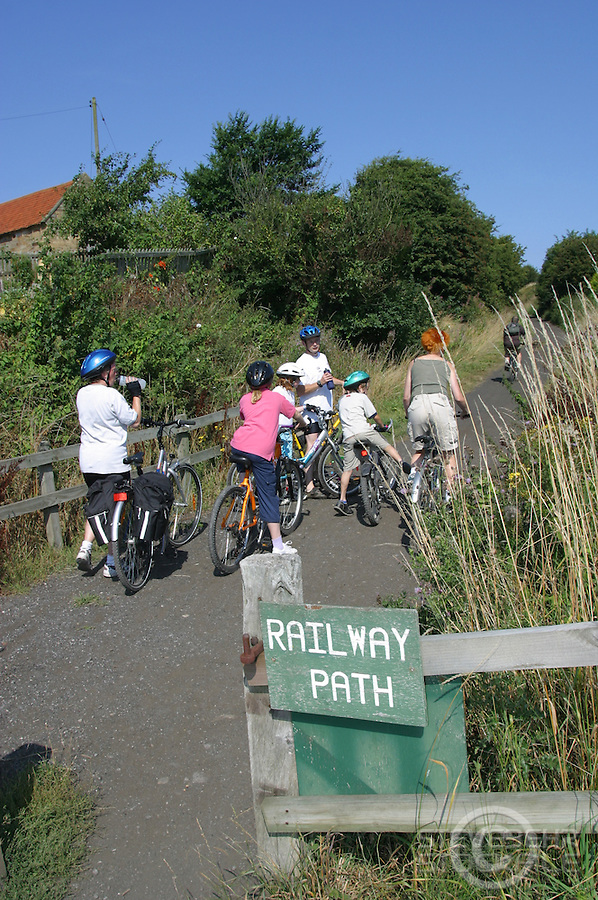 Family cycling on cyclepath between Scarborough and Whitby, along old railway line.