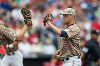Virginia Cavaliers pitcher Connor Jones (33) is greeted by his teammates after recording a crucial out against the Arkansas Razorbacks in Game 1 of the NCAA College World Series on June 13, 2015 at TD Ameritrade Park in Omaha, Nebraska. Virginia defeated Arkansas 5-3. (Andrew Woolley/Four Seam Images)