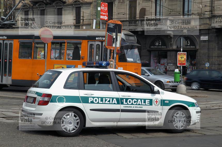 - car of municipal police at tramway terminal in Genoa Gate station square....- auto dei vigili urbani al capolinea dei tram in piazza della stazione di Porta Genova