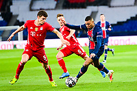 13th April 2021; Parc de Princes, Paris, France; UEFA Champions League football, quarter-final; Paris Saint Germain versus Bayern Munich;  Kylian Mbappe (PSG) takes on Benjamin Pavard (Bayern)