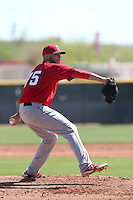 Justin Thomas #75 of the Los Angeles Angels pitches during a Minor League Spring Training Game against the Oakland Athletics at the Los Angeles Angels Spring Training Complex on March 17, 2014 in Tempe, Arizona. (Larry Goren/Four Seam Images)