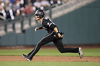 Mississippi State Bulldogs outfielder Jake Mangum (15) takes his lead off of second base during Game 4 of the NCAA College World Series against the Auburn Tigers on June 16, 2019 at TD Ameritrade Park in Omaha, Nebraska. Mississippi State defeated Auburn 5-4. (Andrew Woolley/Four Seam Images)