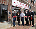 March 11, 2017- Tuscola, IL- Mayor Dan Kleiss cuts the ribbon for the grand opening of Sierra's Place in downtown Tuscola. From left are TEDI's Brian Moody, Dr. Linda March, Mayor Dan Kleiss, Eddie Boutilier, and Tracy Hogan.  [Photo: Douglas Cottle]
