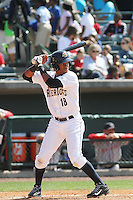 Charleston RiverDogs shortstop Abiatal Avelino #18 at bat  during a game against the Greenville Drive at Joseph P. Riley Jr. Ballpark  on April 9, 2014 in Charleston, South Carolina. Greenville defeated Charleston 6-3. (Robert Gurganus/Four Seam Images)