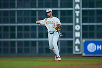Texas Longhorns shortstop Trey Faltine (0) warms up between innings of the game against the LSU Tigers in game three of the 2020 Shriners Hospitals for Children College Classic at Minute Maid Park on February 28, 2020 in Houston, Texas. The Tigers defeated the Longhorns 4-3. (Brian Westerholt/Four Seam Images)