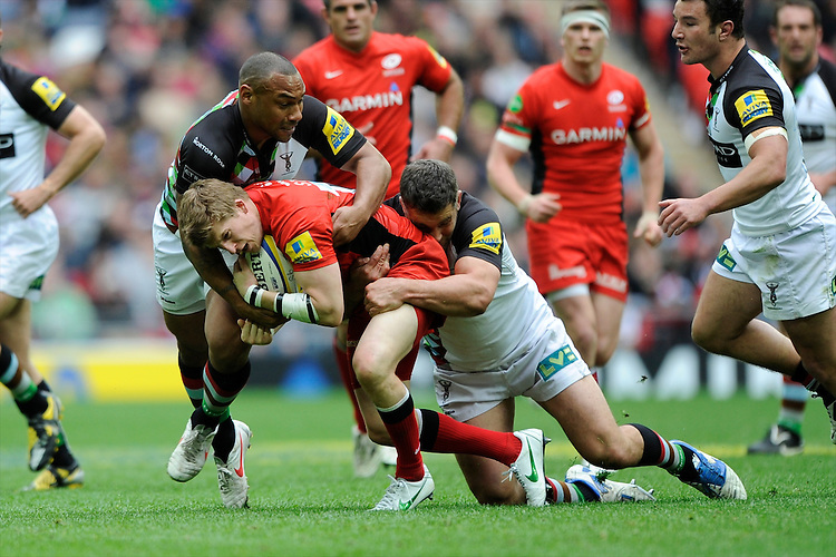 David Strettle of Saracens is tackled by Nick Easter of Harlequins during the Aviva Premiership match between Saracens and Harlequins at Wembley Stadium on Saturday 31st March 2012 (Photo by Rob Munro)