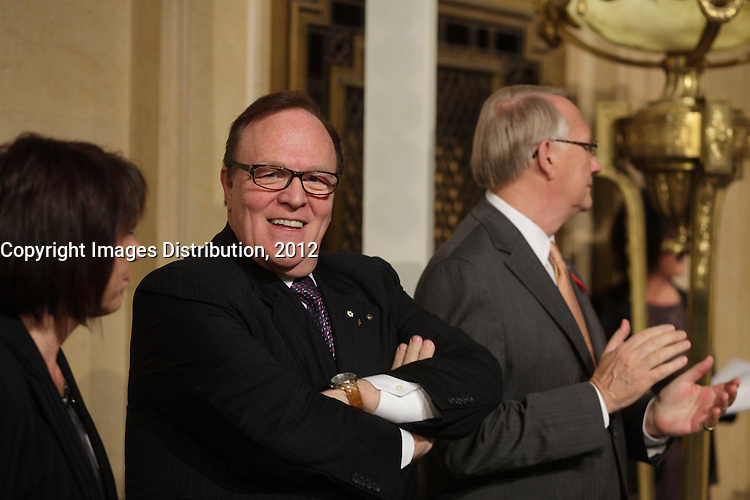 October 29 2012 - Montreal, Quebec, CANADA - Gerald Tremblay, Mayor of Montreal receive at City Hall  local athletes who took part in London 2012  Olympics and Paralympics games.   IN PHOTO : Marcel Aubut, President  Canadian Olympic Committee (L) and Mayor Tremblay (R)