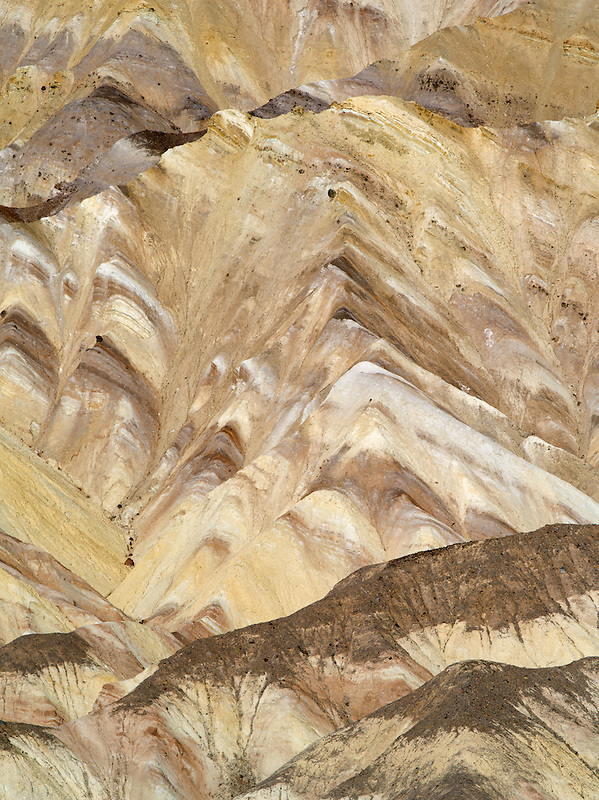 Striated rock formations from Golden Canyon Trail. Death Valley National Park, California