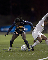 """West Virginia forward Bry McCarthy (33) successful tackle. Boston College defeated West Virginia, 4-0, in NCAA tournament """"Sweet 16"""" match at Newton Soccer Field, Newton, MA."""