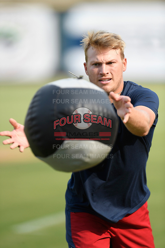 Pitcher Jake Higginbotham (15) of the Rome Braves works out with a weighted ball before a game against the Columbia Fireflies on Tuesday, June 4, 2019, at Segra Park in Columbia, South Carolina. Columbia won, 3-2. (Tom Priddy/Four Seam Images)