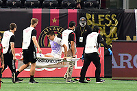 ATLANTA, GA - AUGUST 29: Joao Moutinho #4 of Orlando City is taken from the field on a stretcher during a game between Orlando City SC and Atlanta United FC at Marecedes-Benz Stadium on August 29, 2020 in Atlanta, Georgia.