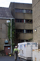 Pictured: Work being carried out at the damaged rear of Ty Elwyn in Llanelli, Wales, UK. Wednesday 15 November 2017<br />