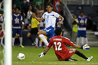 Andy Najar (14) Honduras takes the ball around Mexico goalkeeper Jose Rodriguez... Mexico defeated Honduras 2-1 after extra time to win the CONCACAF Olympic qualifying trophy at LIVESTRONG Sporting Park, Kansas City, Kansas.
