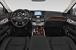 Stock photo of straight dashboard view of a 2015 Infiniti Q70 Base 5 Door Sedan Dashboard