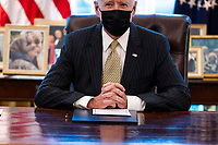 United States President Joe Biden makes remarks prior to  signing the PPP Extension Act of 2021 into law in the Oval Office of the White House in Washington, DC, Tuesday, March, 30 2021. <br /> CAP/MPI/RS<br /> ©RS/MPI/Capital Pictures