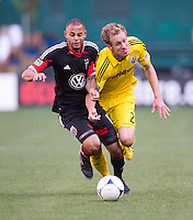 Kyle Porter (19) of D.C. United fights for the ball with Tyson Wahl (2) of the Columbus Crew during the game at RFK Stadium in Washington, DC.  Columbus Crew defeated D.C. United, 2-1.