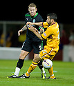 HIBERNIAN'S GARRY O'CONNOR AND MOTHERWELL'S TIM CLANCY CHALLENGE FOR THE BALL