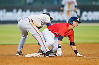 Michael Marjama (12) of the Kannapolis Intimidators slides into second base ahead of the tag from Jose Peraza (4) of the Rome Braves at CMC-Northeast Stadium on April 25, 2013 in Kannapolis, North Carolina.   (Brian Westerholt/Four Seam Images)