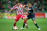MELBOURNE, AUSTRALIA - DECEMBER 11: Diogo Ferreira of the Heart and Nick Kalmar of the Victory compete for the ball during the round 18 A-League match between the Melbourne Heart and Melbourne Victory at AAMI Park on December 11, 2010 in Melbourne, Australia. (Photo by Sydney Low / Asterisk Images)