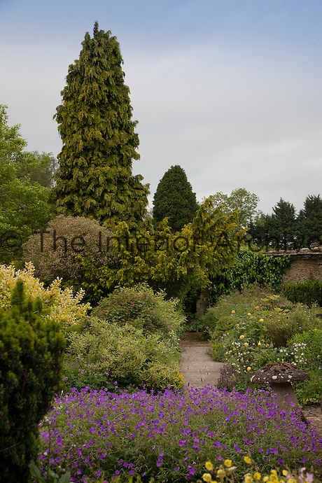 The colourful flowerbeds and shrubs at Rodmarton are designed to encourage butterflies and provide shelter for birds