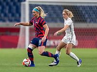 SAITAMA, JAPAN - JULY 24: Julie Ertz #8 of the USWNT dribbles during a game between New Zealand and USWNT at Saitama Stadium on July 24, 2021 in Saitama, Japan.