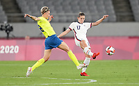 TOKYO, JAPAN - JULY 20: Abby Dahlkemper #17 of the United States clears a ball during a game between Sweden and USWNT at Tokyo Stadium on July 20, 2021 in Tokyo, Japan.