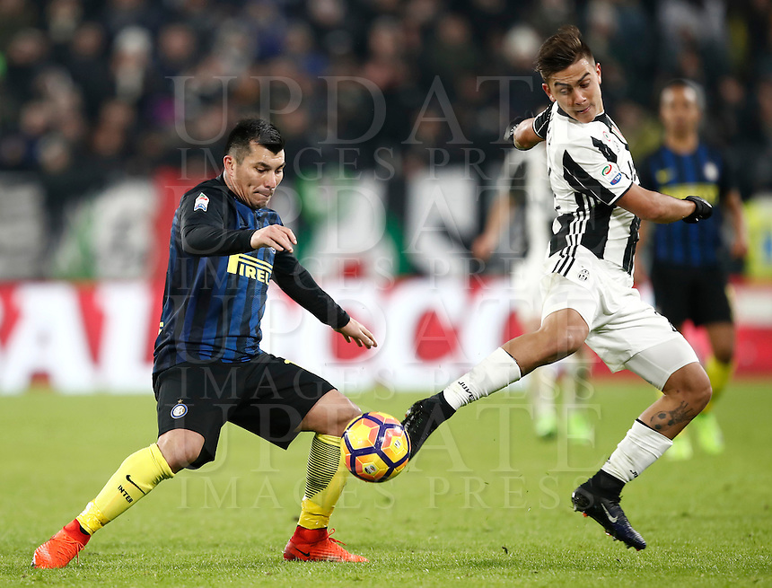 Calcio, Serie A: Torino, Juventus Stadium, 5 febbraio 2017.<br /> Inter Milan's Gary Medel (l) in action with Juventus' Paulo Dybala (r) during the Italian Serie A football match between Juventus and Inter Milan at Turin's Juventus Stadium, on February 5, 2017.<br /> UPDATE IMAGES PRESS/Isabella Bonotto