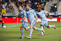 Jacob Peterson (37) of Sporting Kansas City\ celebrates scoring with teammates. Sporting Kansas City defeated the Philadelphia Union 2-0 during the semifinals of the 2012 Lamar Hunt US Open Cup at PPL Park in Chester, PA, on July 11, 2012.
